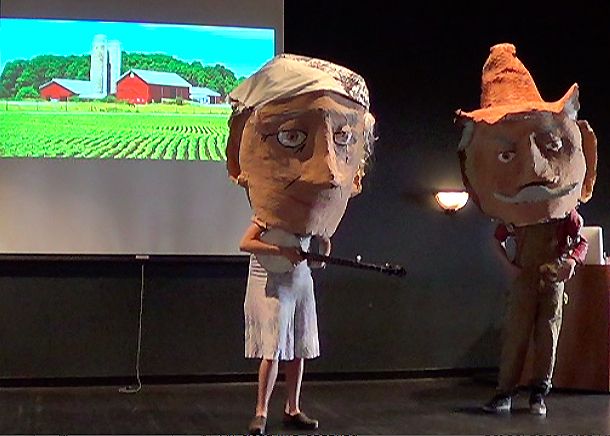 Large_fit_monsanto farmers puppet show 1